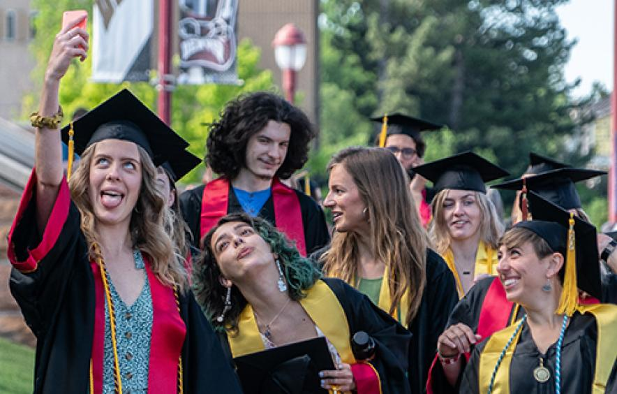 Students taking photos before graduation.