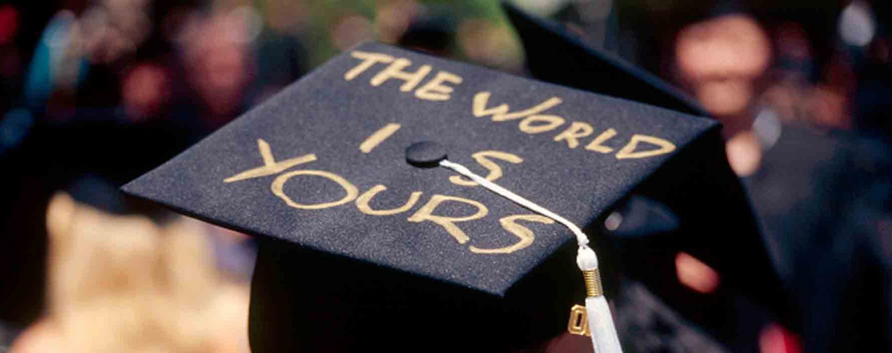 "Student's graduation cap reading, ""The world is yours."""